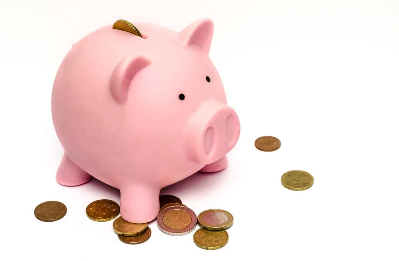 Tirelire cochon rose, argent pièces de monnaie